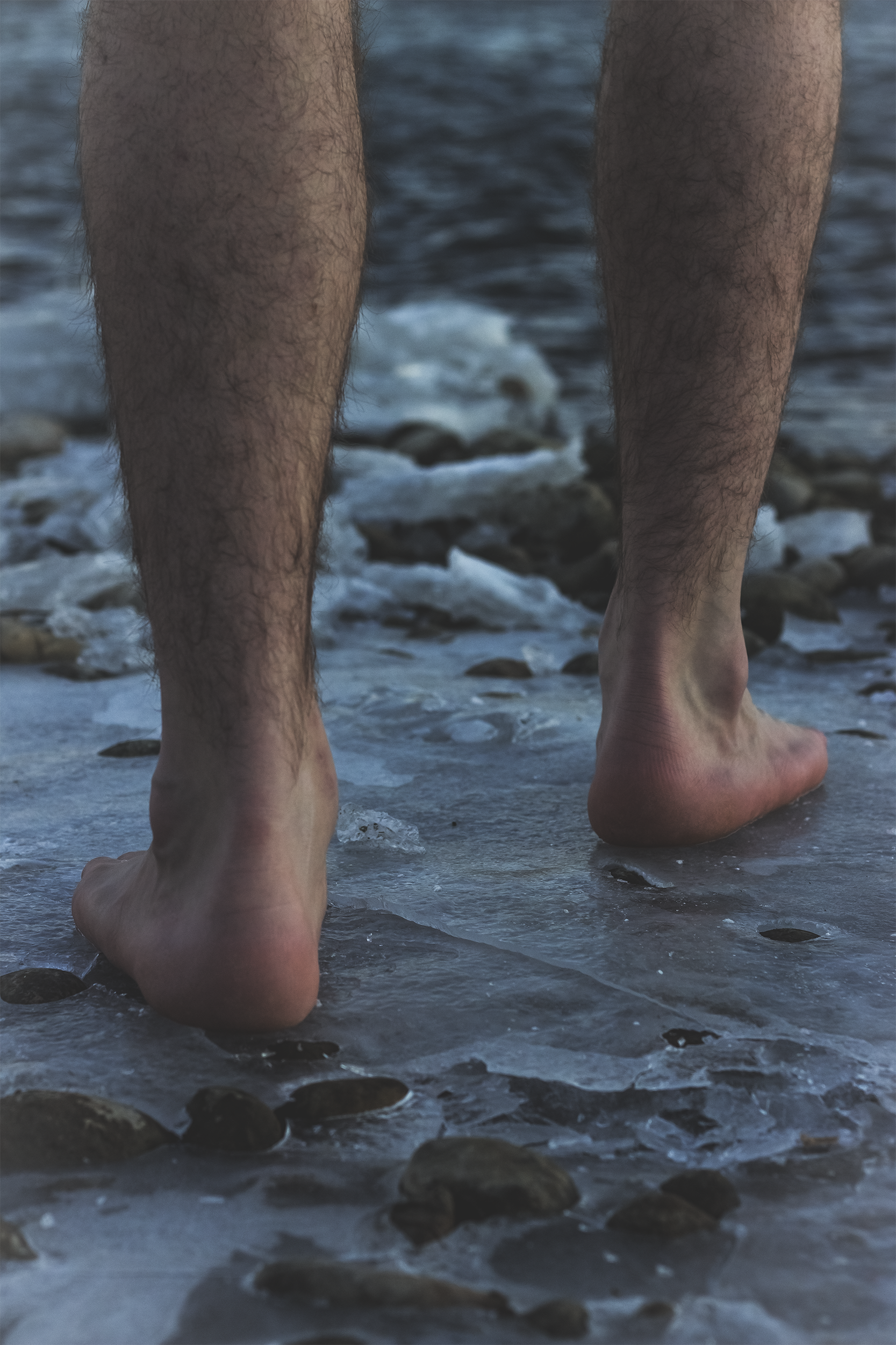 Feet standing on Ice